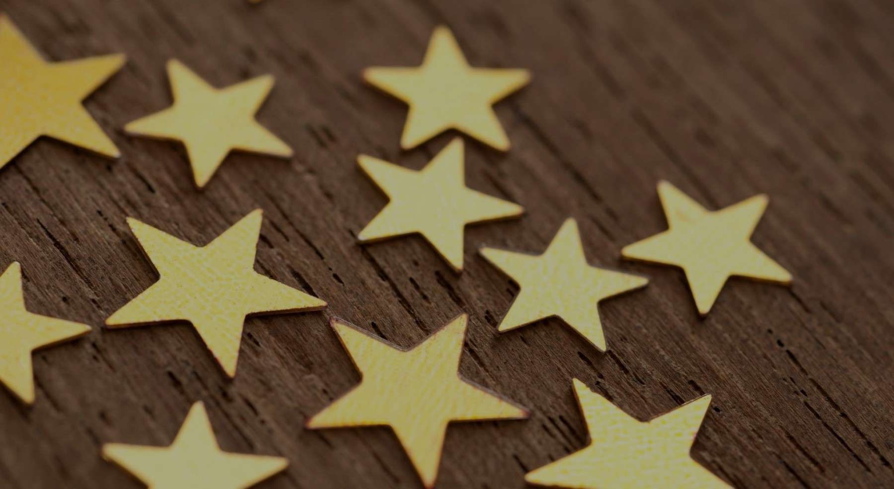 Gold stars on wooden surface